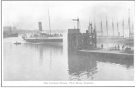Paddle Steamers at landing stage.
