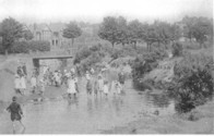 Children playing in brook at Rec.
